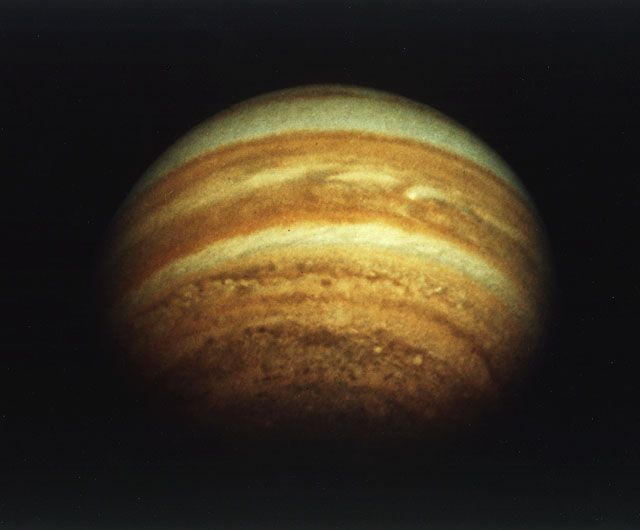 The planet Jupiter as seen from above<br /> its north pole by Pioneer 11. The pole<br /> itself is roughly on the line of the<br /> terminator (boundary between Jovian<br /> day and night) across the top of the<br /> planet. Image credit: NASA Ames&nbsp;&nbsp;&nbsp;&nbsp;<br /> <a href='http://www.nasa.gov/centers/ames/images/content/739470main_JUP_74HC680.jpg' class='bbc_url' title='External link' rel='nofollow external'>Click for full resolution</a>
